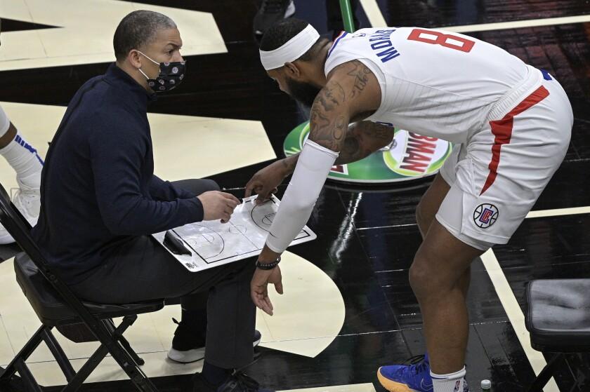 Clippers coach Tyronn Lue talks strategy with forward Marcus Morris Sr.
