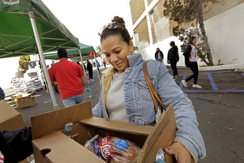 Myra Madrid, a housekeeper at Four Seasons in Beverly Hills for 10 years, was among about 800 hotel workers who showed up at a food bank set up by Unite Here Local 11 on Tuesday at the Hospitality Training Academy.