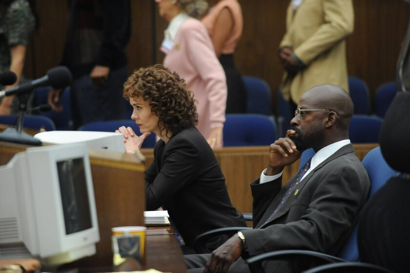 """In this image released by FX, Sarah Paulson portrays Marcia Clark, left, and Sterling K. Brown portrays Christopher Darden in a scene from """"The People v. O.J. Simpson: American Crime Story,"""" a 10-part series debuting Tuesday, Feb. 2, at 10 p.m. EST Tuesday. (Ray Mickshaw/FX via AP)"""