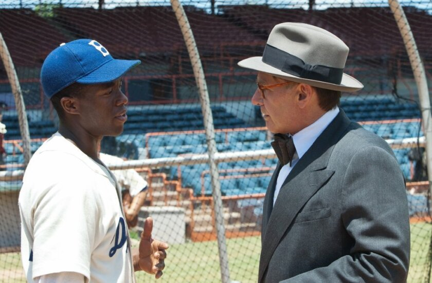 """Chadwick Boseman and Harrison Ford in """"42."""""""