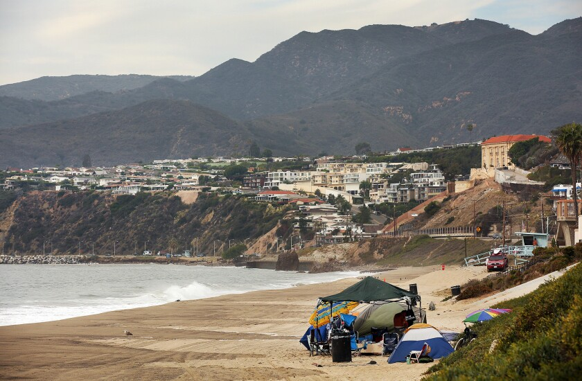 A collection of tents  along Will Rogers State Beach in 2015