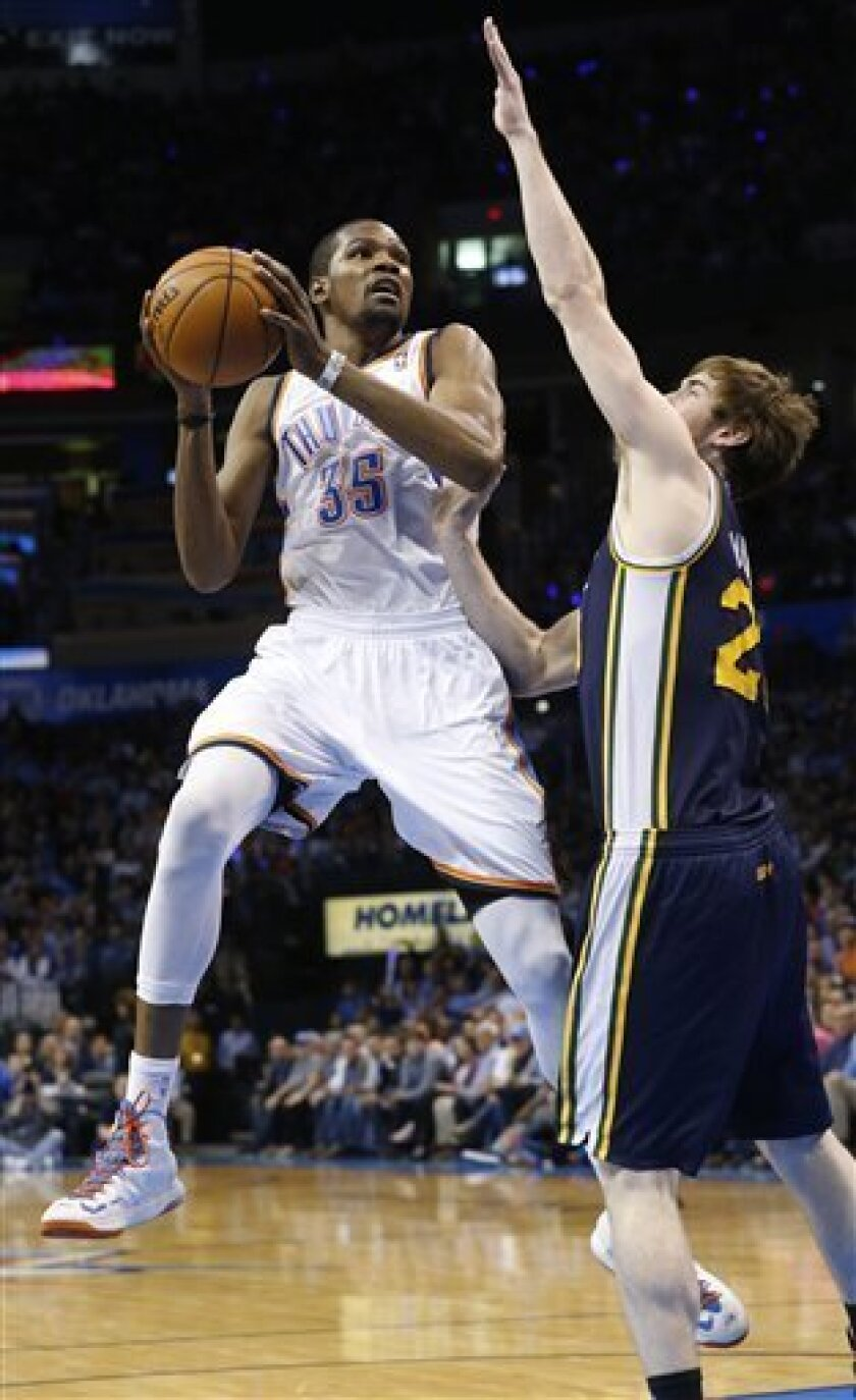 Oklahoma City Thunder forward Kevin Durant (35) shoots in front of Utah Jazz guard Gordon Hayward (20) in the second quarter of an NBA basketball game in Oklahoma City, Wednesday, March 13, 2013. (AP Photo/Sue Ogrocki)