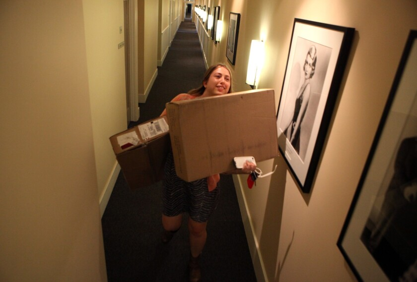 """""""Witches of East End"""" production assistant Amy Thurlow carries boxes from the mailroom at Sunset Bronson Studios in Hollywood in 2014."""