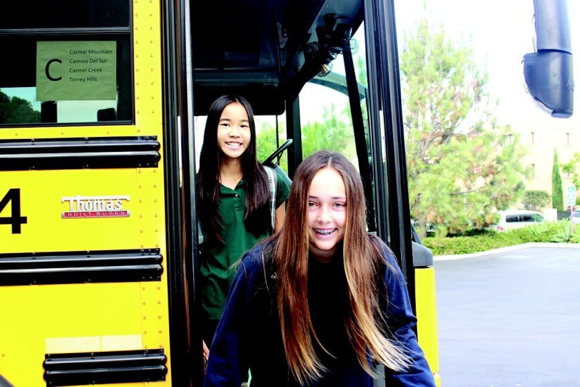 Julia Chen and Sammie Stone jump off the bus and onto The Bishop's campus.