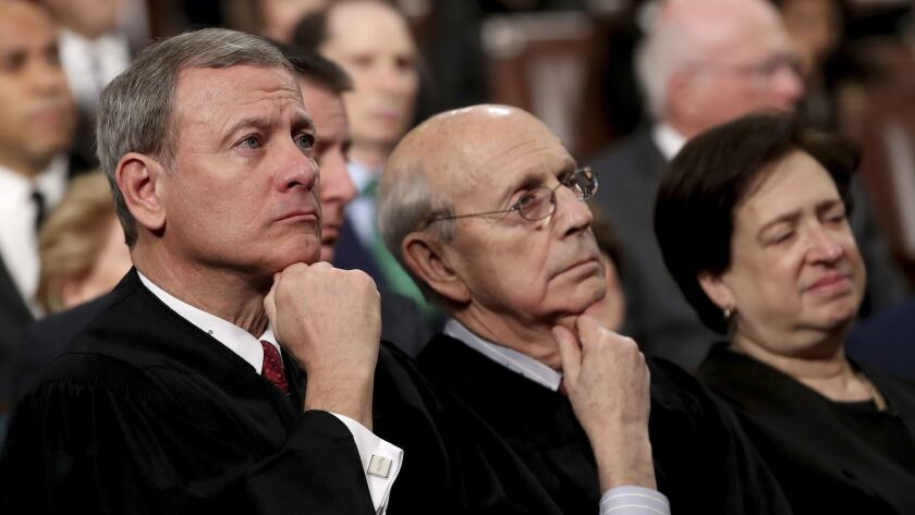 Chief Justice John Roberts, from left, and Justices Stephen Breyer and Elena Kagan