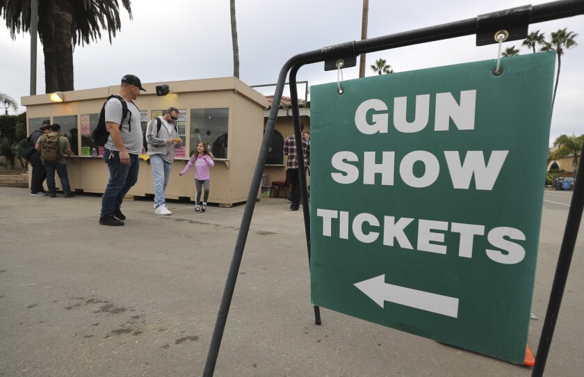 People buy tickets to the Crossroads of the West Gun Show at the Del Mar Fairgrounds in December.