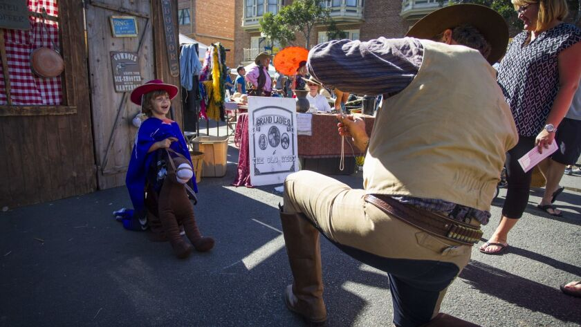 A dress up booth provided children and families with old western style pictures to take home.