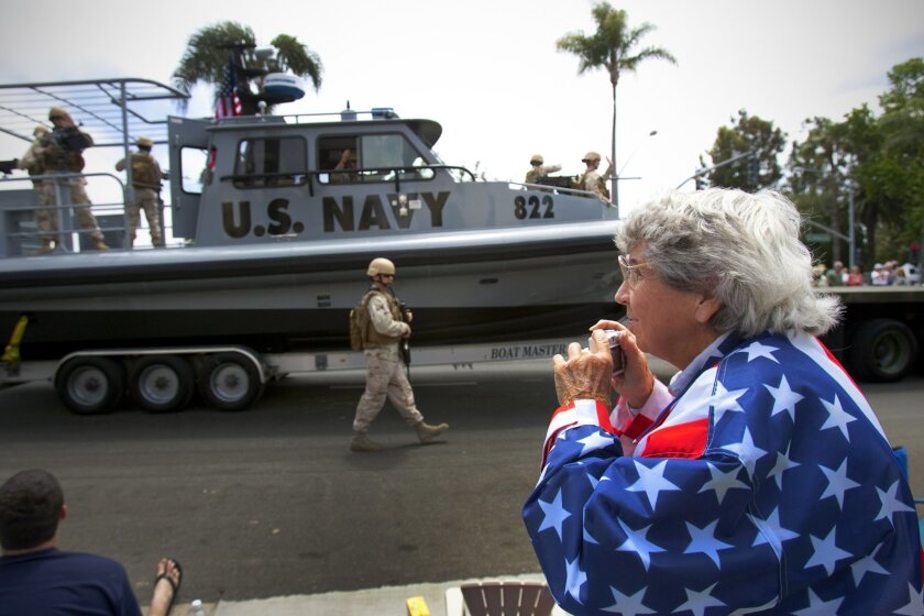 """Virginia St. John of Lakeside shows her support for the military at Coronado's 62nd annual Independence Day Parade on Saturday. The parade's theme was """"A Salute to America's Heroes."""""""