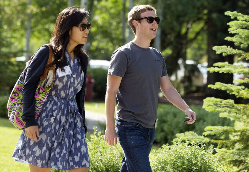 Facebook CEO Mark Zuckerberg and his wife, Dr. Priscilla Chan, in 2011.