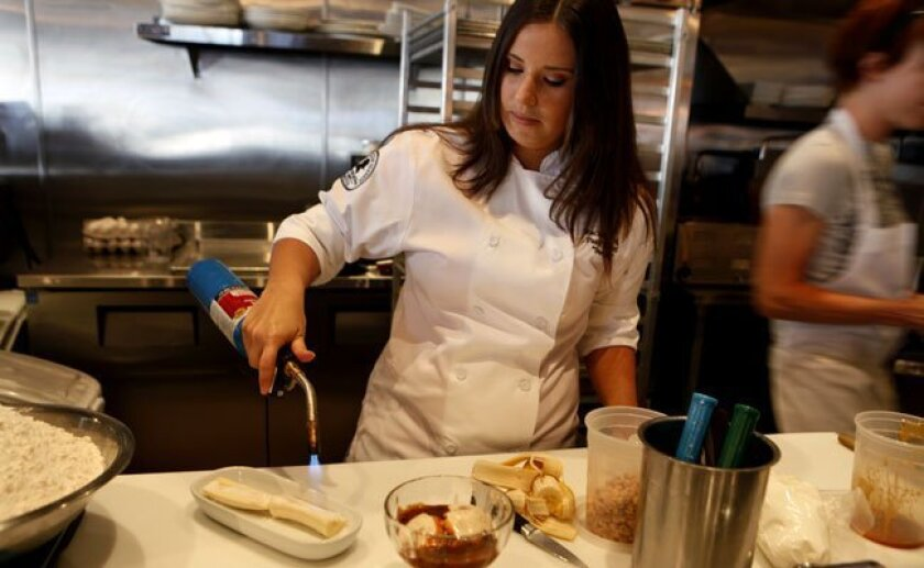Searsucker's pastry chef Rachel King works her magic on the King Sundae, in full view of diners.