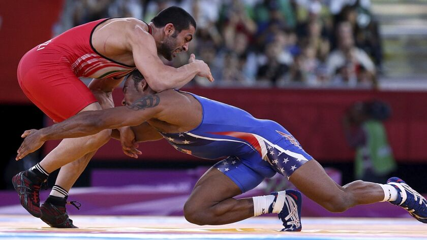 U.S. wrestler Jordan Burroughs competes against Iran's Sadegh Saeed in the men's 74-kilogram freestyle wrestling gold medal match at the 2012 Olympics in London.