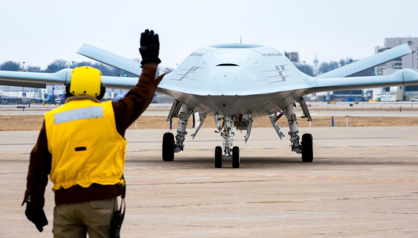 Boeing's MQ-25 prototype maneuvers through a deck-handling demonstration in February in St. Louis. Boeing has won a contract to build four MQ-25 flying tankers.