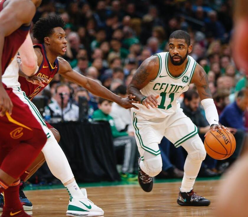 Boston Celtics guard Kyrie Irving (R) drives past defending Cleveland Cavaliers guard Collin Sexton (L) during the second half of the NBA basketball game between the Cleveland Cavaliers and the Boston Celtics at the TD Garden in Boston, Massachusetts, USA, 30 November 2018. EFE