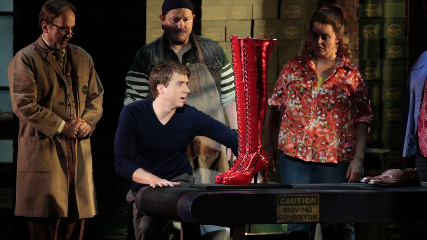 """Charlie (Steven Booth, second from left), the inheritor of a hard-luck shoe factory, turns rhapsodic as the first pair of a new product rolls off the line. A touring production of the musical """"Kinky Boots"""" is at the Pantages Theatre in Hollywood through Nov. 30."""