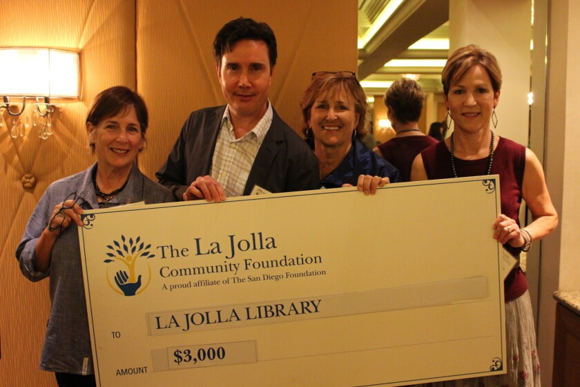La Jolla Community Foundation member Tracy Nelson, Riford Library branch manager Shaun Briley, Cindy Olmstead and La Jolla Community Foundation member Sue Wagener.