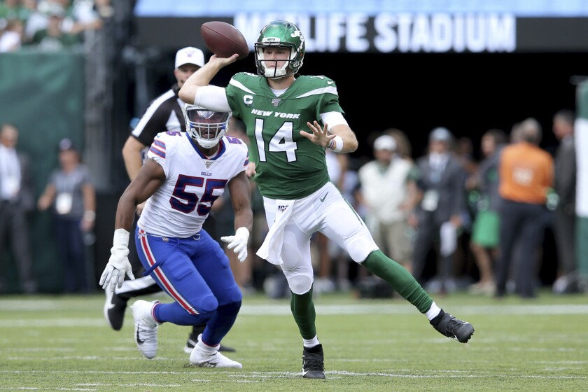 New York Jets quarterback Sam Darnold (14) in action against Buffalo Bills defensive end Jerry Hughes (55) during an NFL football game on Sunday, Sep. 8, 2019, in East Rutherford, N.J. (Brad Penner/AP Images for Panini)