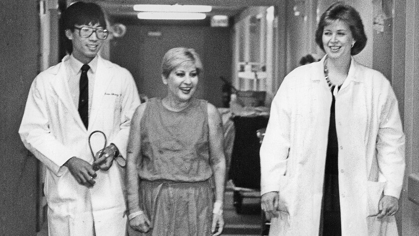 Patient Clara Clements, center, with Dr. Patrick Soon-Shiong, left, and nurse Eileen Demayo in 1986.