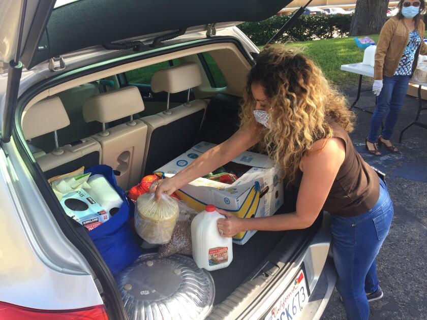 La Colonia de Eden Gardens, Inc., recently held its third free food distribution.