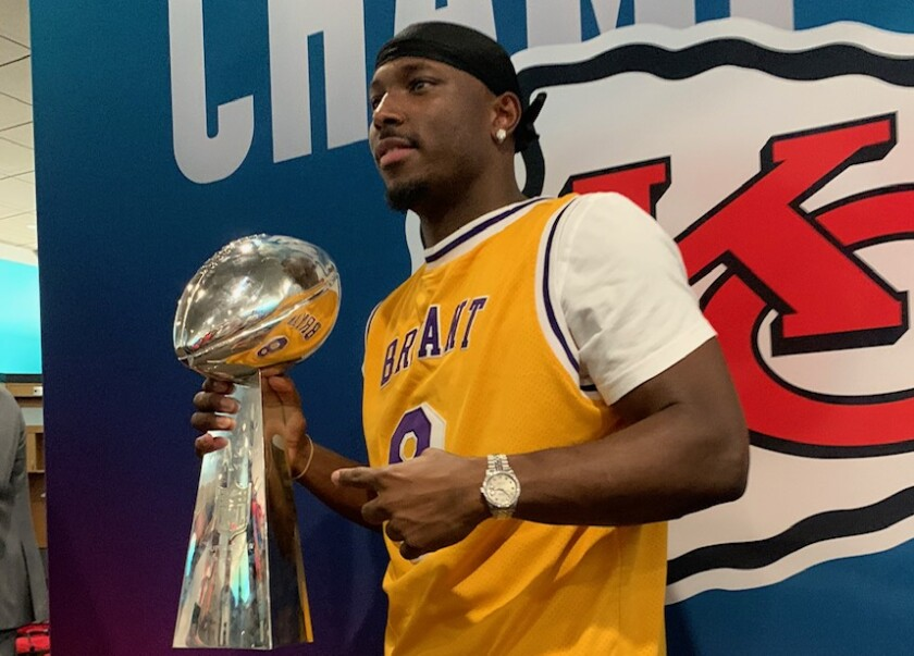 Kansas Chiefs running back LeSean McCoy wears a Kobe Bryant jersey while holding the Vince Lombardi trophy following the team's Super Bowl LIV win over the 49ers on Sunday.