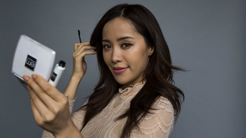 SANTA MONICA, CA - July 14, 2014: YouTube star Michelle Phan is photographed with her L'Oreal makeu