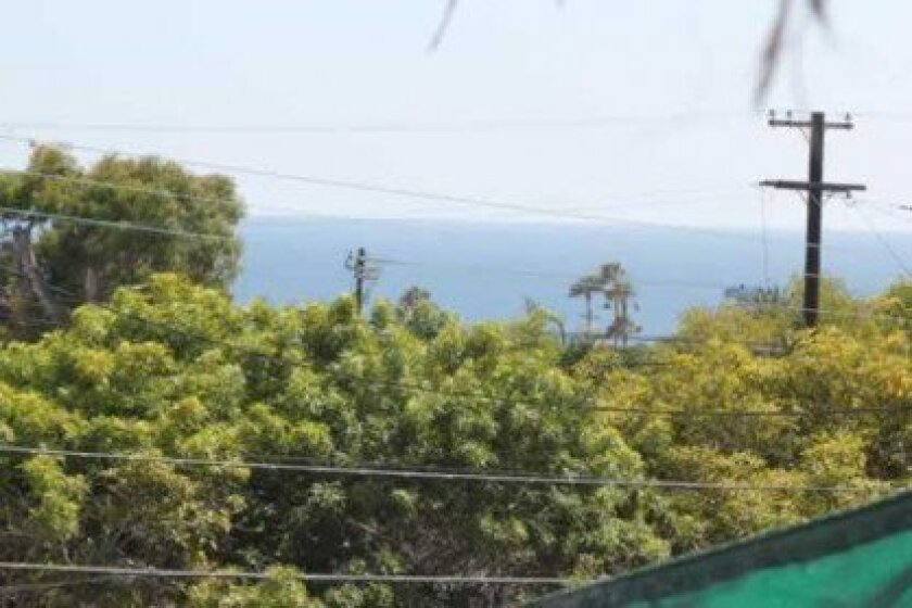 What is left of Steve Sillman's ocean view is visible from the deck of his Archer Street home.
