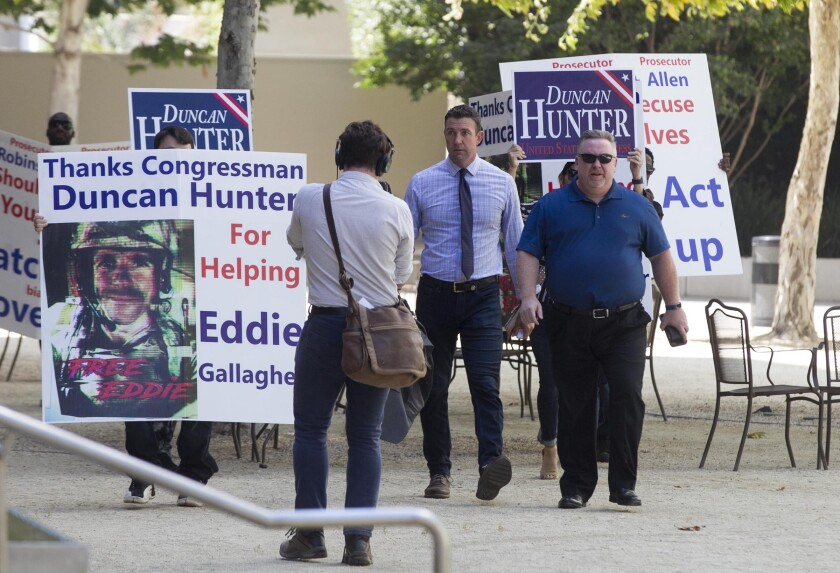 Surrounded by supporters, Duncan Hunter made his way to federal court in San Diego in August.