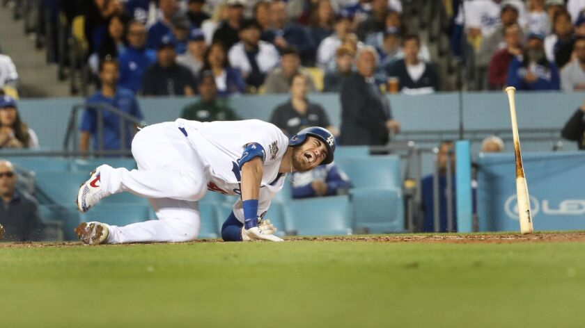 LOS ANGELES, CA - APRIL 15, 2019: Dodgers Cody Bellinger screams in pain after getting hit by a pitc
