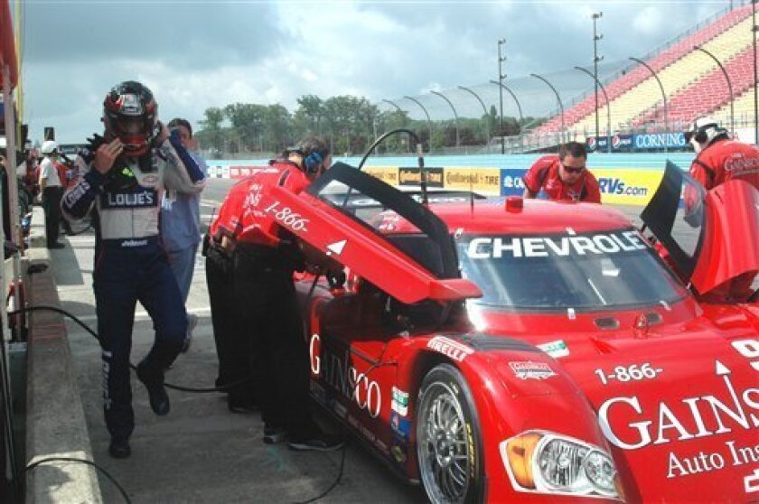 NASCAR Sprint Cup Series driver Jimme Johnson leaves the Chevrolet Riley Daytona Prototype of Gainesco racing after practice for the Sahlen's 6 hours of Watkins Glen, in Watkins Glen, N.Y., Friday June 4, 2010. The four-time Sprint Cup champion is competing Saturday at Watkins Glen International in