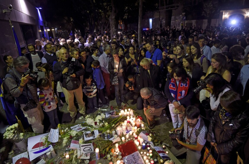 People gather outside the French Embassy in Mexico City on Nov. 16, 2015, in solidarity with the victims of the attacks in Paris.