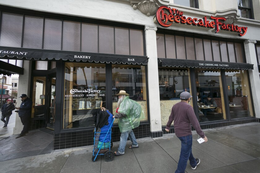 """FILE - This Feb. 3, 2017 file photo shows The Cheesecake Factory restaurant in Old Pasadena, Calif. The U.S. Securities and Exchange Commission said Friday, Dec. 4, 2020, that The Cheesecake Factory settled charges that it misled investors on the impact the pandemic was having on its business. The Cheesecake Factory said in March and April government filings that it was """"operating sustainably"""" during the pandemic. (AP Photo/Damian Dovarganes)"""