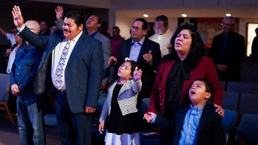 Pastor Noe Carias with wife, Victoria, and their children Nylah and Abraham at their East L.A. churc