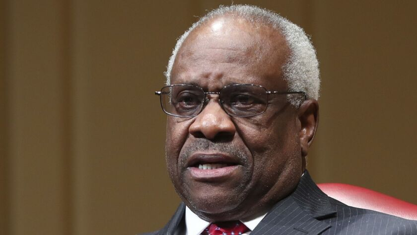 Associated Justice Clarence Thomas speaks during an event at the Library of Congress in Washington,