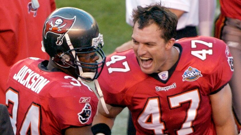 Tampa Bay Buccaneers safety John Lynch (47) congratulates teammate Dexter Jackson (34) after Jackson intercepted a pass against the Oakland Raiders in the second quarter during Super Bowl XXXVII in San Diego.