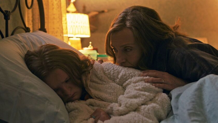 """Milly Shapiro, left, and Toni Collette in a scene from """"Hereditary."""""""