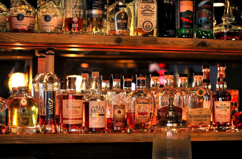 """High-end liquor lines shelves behind the bar in The Charles Kenneth """"speakeasy"""" bar in the basement of the historic old building that houses the Land & Water Company restaurant and bar."""