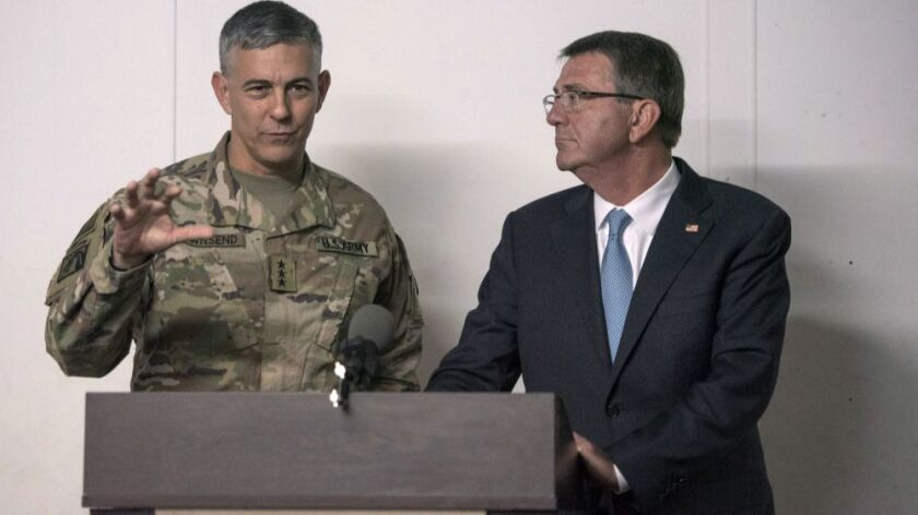 Defense Secretary Ashton Carter listens as U.S. Army Lt. Gen. Stephen Townsend, commander of Combined Joint Task Force-Operation Inherent Resolve, speaks during a news conference in Irbil, Iraq, on Oct. 23, 2016.