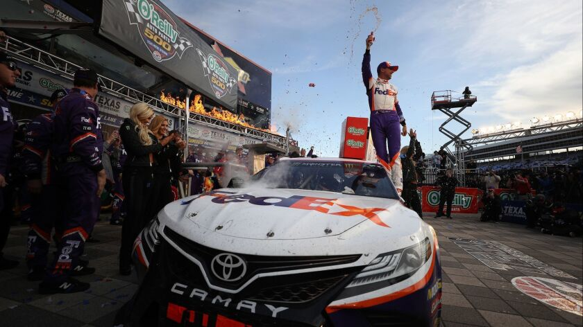 Denny Hamlin celebrates in victory lane after winning Sunday's NASCAR race at Texas Motor Speedway.