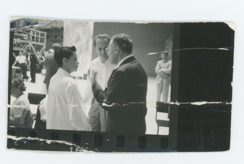 "Garland, left, with Luft and director George Cukor on the set of ""A Star Is Born."""