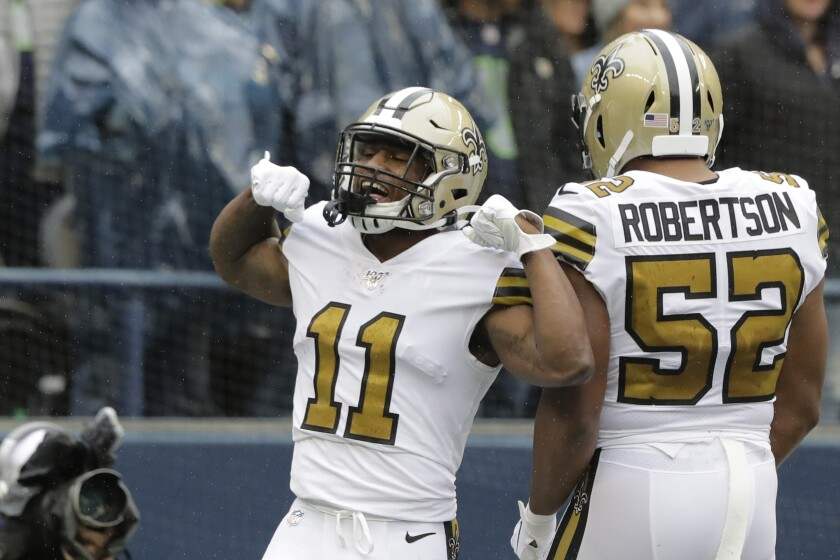 New Orleans Saints' Deonte Harris (11) celebrates his touchdown on a punt return against the Seattle Seahawks during the first half of an NFL football game Sunday, Sept. 22, 2019, in Seattle. (AP Photo/Ted S. Warren)