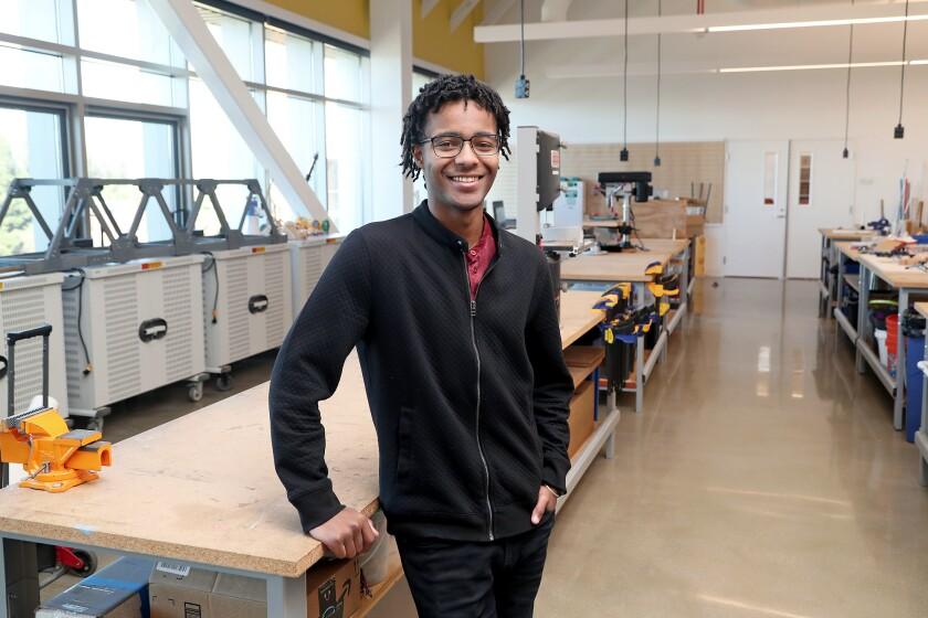 William Parker, 20, stands in his former Samueli Academy school's engineering lab.