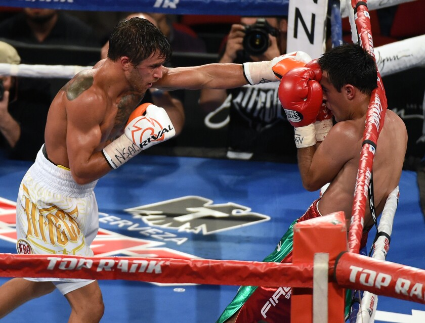 Lomachenko's rapid-fire blows too much for Koasicha in 10th round knockout