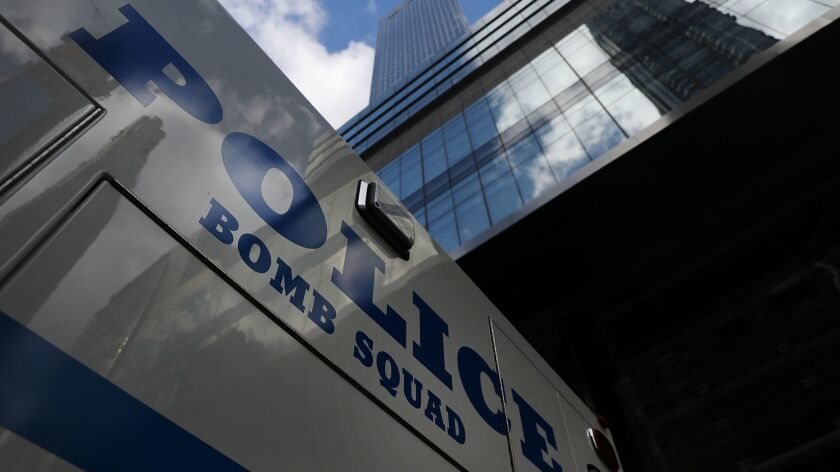 A police vehicle sits outside of the Time Warner Center after an explosive device was found Oct. 24 in New York City.