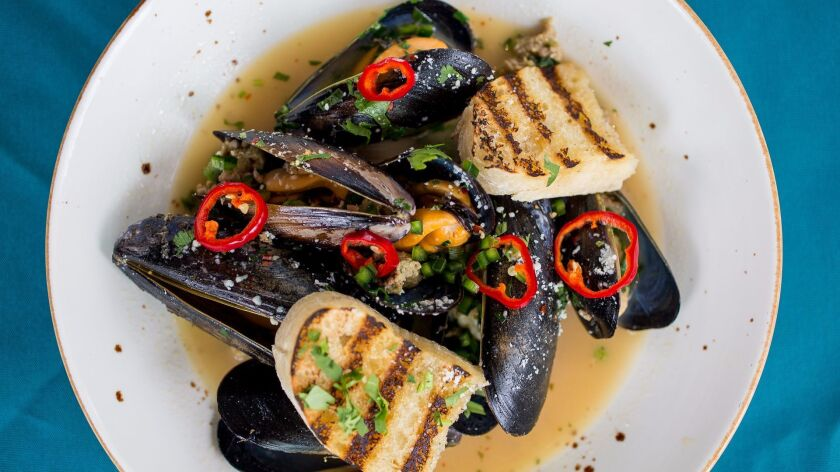 Mussels with green chorizo, chiles and jalepeno Bolillo at Pueblo in Pacific Beach.