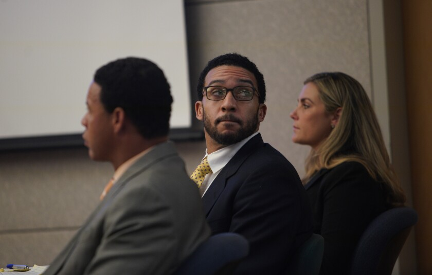 Sitting in Superior Court in Vista during his first trial, Kellen Winslow II (second from right) is flanked by defense attorneys, Brian Watkins (left) and Emily Bahr (right) during closing arguments in June. Testimony in his retrial starts Monday. He has pleaded not guilty to charges of sexually assault involving three accusers.