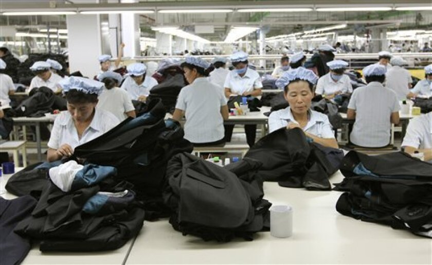 FILE - In this Sept. 21, 2012 file photo, North Korean workers assemble Western-style suits at the South Korean-run ShinWon Corp. garment factory inside the Kaesong industrial complex in Kaesong, North Korea. South Korea's government said Thursday, July 4, 2013 that it has has reached out to North Korea to discuss restarting the jointly run factory park after weeks of testy silence between the two sides. The industrial complex in the North Korean city of Kaesong, just north of the Demilitarized