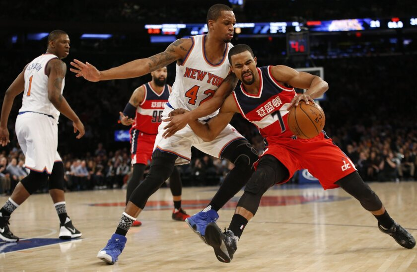 Washington Wizards guard Ramon Sessions (7) struggles as New York Knicks forward Lance Thomas (42) pressures in the first half of an NBA basketball game at Madison Square Garden in New York, Tuesday, Feb. 9, 2016. (AP Photo/Kathy Willens)