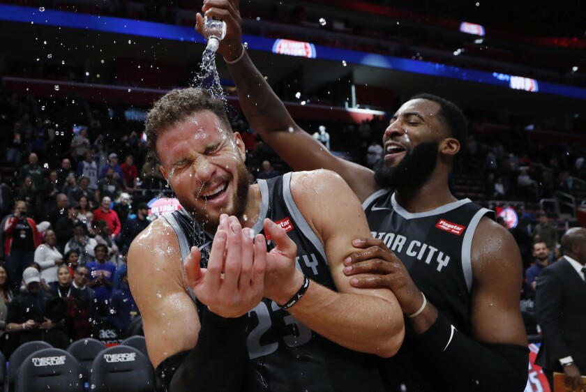 Detroit forward Blake Griffin is doused with water by teammate Andre Drummond after the Pistons defeated the Rockets 116-111 in overtime on Friday.