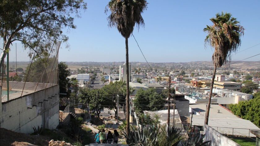 The view from Tijuana's Cerro Altamira. The bare hills in the distance are the United States.