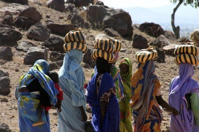 In this image provided by Physicians for Human Rights, Darfuri women return to a UN refugee camp near Farchana, Chad in Nov. 2008. The U.S.-based group Physicians for Human Rights said a survey of women who fled violence in Darfur found that a third of them reported or showed signs of rape, and rev