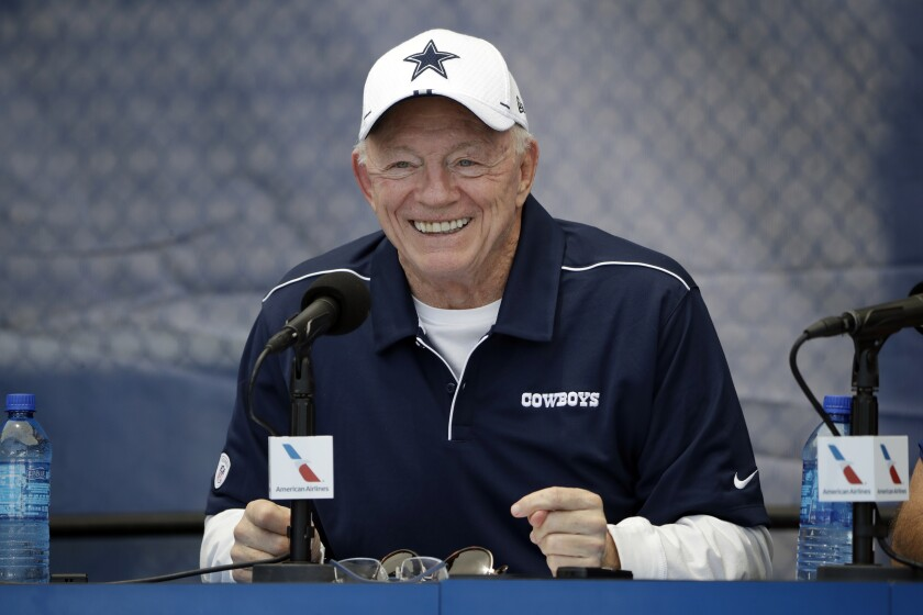 Dallas Cowboys owner Jerry Jones smiles while speaking at a news conference during 2019 training camp in Oxnard.